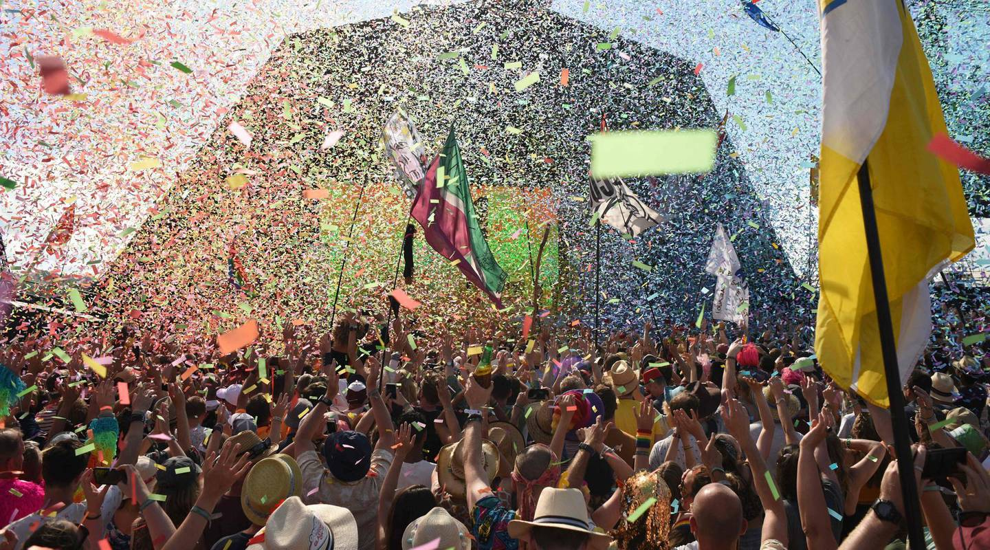 (FILES) In this file photo taken on June 30, 2019, revellers cheer as Australian singer Kylie performs at the Glastonbury Festival of Music and Performing Arts on Worthy Farm near the village of Pilton in Somerset, South West England. Britain's Glastonbury Festival has announced a livestreamed concert in May at its famous southwest English farm site, after the pandemic led to the blockbuster event's cancellation for the second consecutive summer. -   / AFP / Oli SCARFF