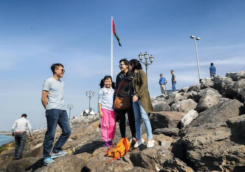 Abu Dhabi, U.A.E., February 10, 2018.  Chinese tourists enjoying the Abu Dhabi sights at the UAE Heritage Village.Victor Besa / The NationalNationalRequested By:  Olive Obina