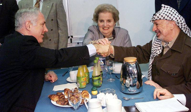 Israeli Prime Minister Benjamin Netanyahu, United States Secretary of State Madeleine Albright and Palestinian leader Yasser Arafat (from L to R) prepare to start their meeting at an Israeli military base at the Erez crossing point, the main point of passage from the Gaza Strip into Israel. The three met for the third time in two weeks in an intensive US push to seal a new interim Mideast peace accord. (Photo by MENAHEM KAHANA / AFP)