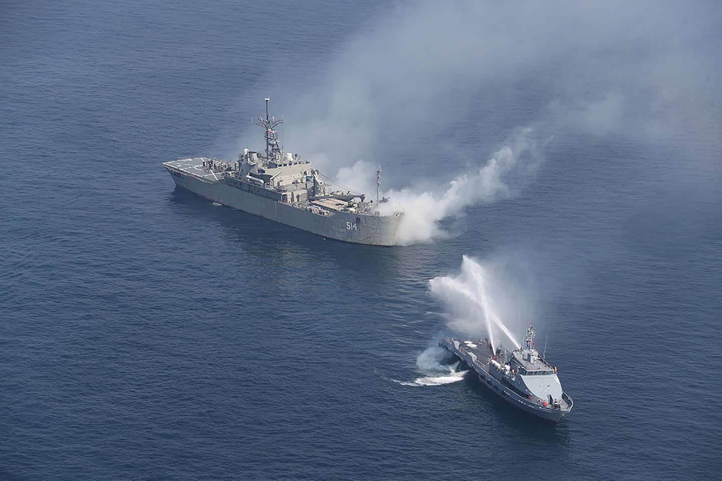 Iranian warships are seen during a joint naval exercise with Russian navy in the Indian Ocean, Iran February 16, 2021. Picture taken February 16, 2021. Iranian Army/WANA (West Asia News Agency) via REUTERS ATTENTION EDITORS - THIS IMAGE HAS BEEN SUPPLIED BY A THIRD PARTY.