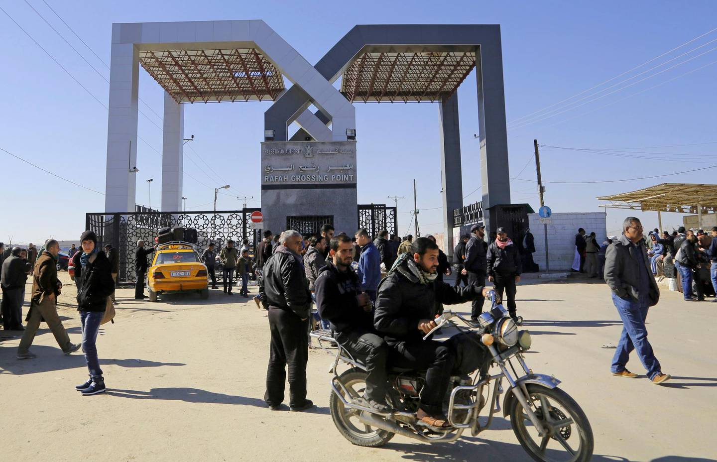 FILE - In this Tuesday, Jan. 20, 2015 file photo, Palestinians wait to cross the border to the Egyptian side at the Rafah crossing, in the southern Gaza Strip.Egypt's President Abdel Fatah el-Sissi says he has ordered the Rafah crossing point with Gaza strip be opened for the whole Muslim holy month of Ramadan, the longest time since Hamas took over the territory in 2007.  (AP Photo/Adel Hana, File)