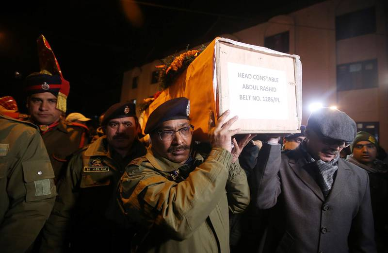 Indian police officers carry the coffin containing the body of their fallen colleague, who according to police was killed in a gun battle between suspected militants and security forces in south Kashmir's Pulwama district, during his wreath-laying ceremony in Srinagar, February 18, 2019. REUTERS/Danish Ismail