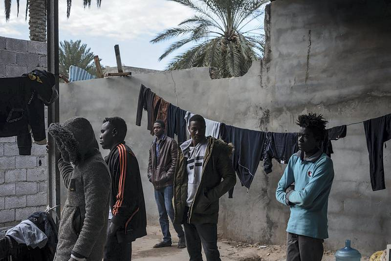 Refugees mostly from Darfur, Sudan are gathered in the courtyard of the place where they live in Gorgi district, south of Tripoli. Migrants and refugees are often living in dire conditions, in dilapidated buildings or small unfinished houses deprived of basic services.