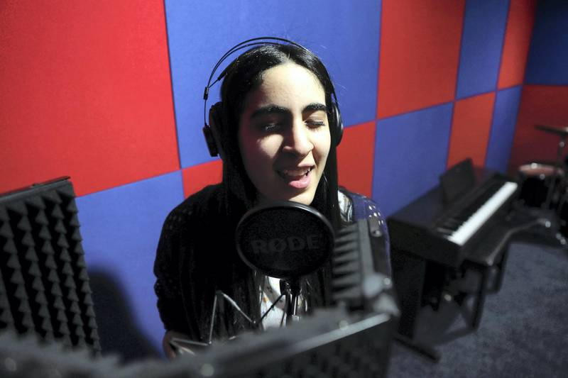 DUBAI ,  UNITED ARAB EMIRATES , JULY 1 -2019 :- Sara Al Hashimi, student of KING's School Al Barsha Dubai, has autism and has managed to win a scholarship to the music college at Berklee singing at the music room at the school campus in Dubai. ( Pawan Singh / The National ) For News. Story by Anam