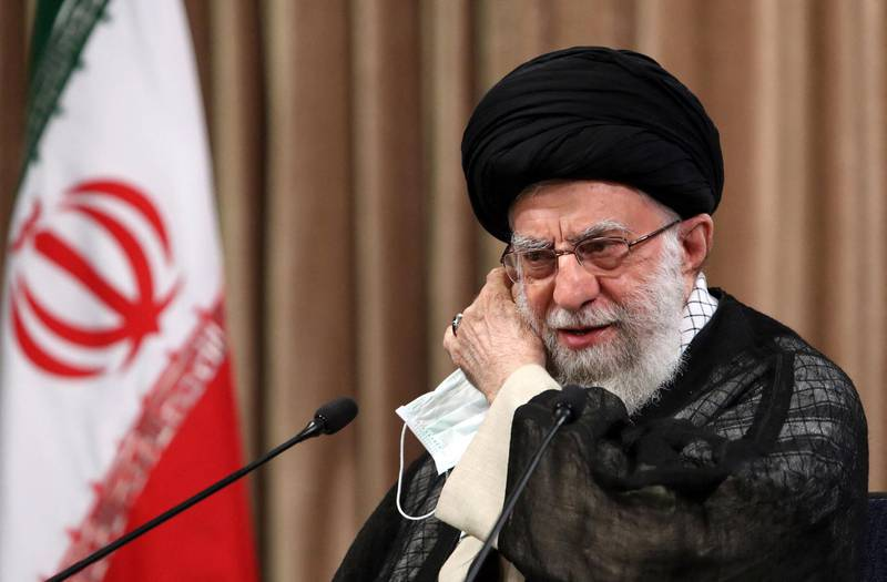 """A handout picture provided by the office of Iran's Supreme Leader Ayatollah Ali Khamenei on May 2, 2021 shows him giving a live televised speech in the capital Tehran. Iran's supreme leader slammed as a """"big mistake"""" leaked remarks by his foreign minister, a week after audio emerged of the diplomat bemoaning the military's influence on diplomacy. Top diplomat Mohammad Javad Zarif made the remarks in a three-hour conversation first published by media outlets outside the country a week ago, provoking anger from conservatives. - === RESTRICTED TO EDITORIAL USE - MANDATORY CREDIT """"AFP PHOTO / HO / KHAMENEI.IR"""" - NO MARKETING NO ADVERTISING CAMPAIGNS - DISTRIBUTED AS A SERVICE TO CLIENTS ===  / AFP / KHAMENEI.IR / - / === RESTRICTED TO EDITORIAL USE - MANDATORY CREDIT """"AFP PHOTO / HO / KHAMENEI.IR"""" - NO MARKETING NO ADVERTISING CAMPAIGNS - DISTRIBUTED AS A SERVICE TO CLIENTS ==="""