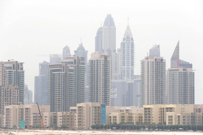 DUBAI , UNITED ARAB EMIRATES , JULY 28 – 2018 :- View of the residential towers in Greens and Dubai Marina during the hazy weather in Dubai. ( Pawan Singh / The National )  For News.