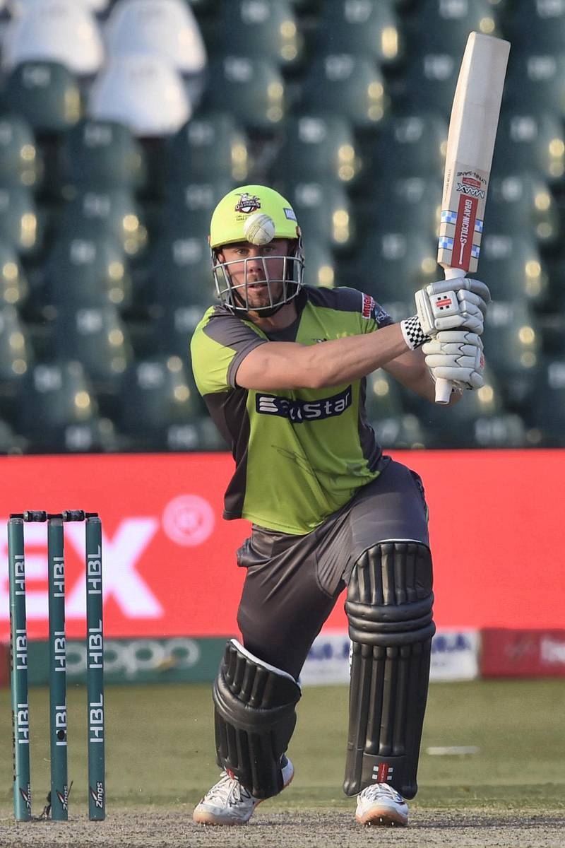 Lahore Qalandars Chris Lynn plays a shot during the Pakistan Super League (PSL) T20 cricket match between Lahore Qalandars and Multan Sultans at the Gaddafi Cricket Stadium in Lahore on March 15, 2020. (Photo by Arif ALI / AFP)