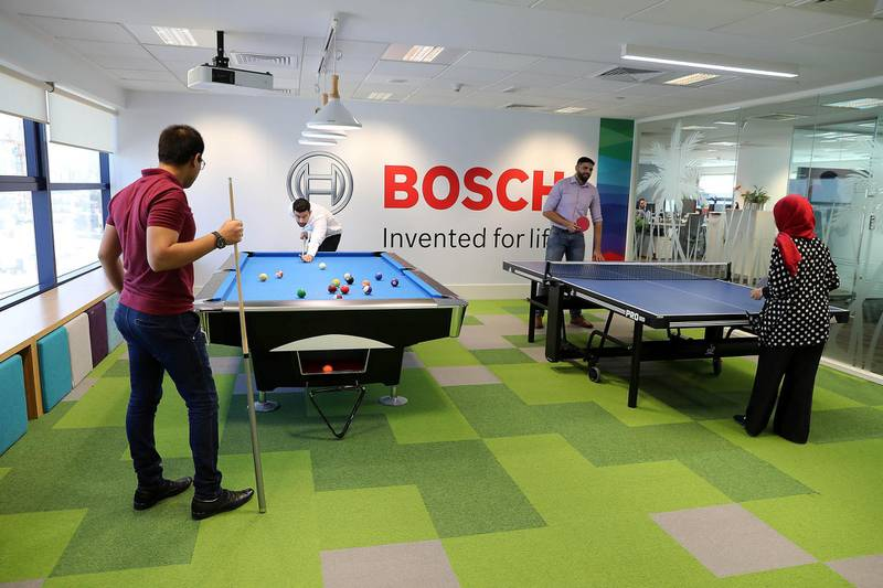 DUBAI , UNITED ARAB EMIRATES, September 12 – 2018 :- Employees playing snooker and table tennis in the recreational room at the Bosch Middle East office in Dubai Airport Free zone in Dubai. ( Pawan Singh / The National )  For News. Story by Gillian