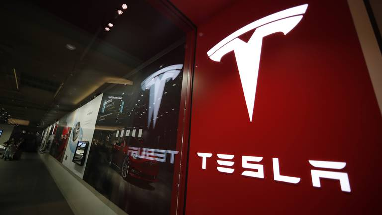 An image that illustrates this article Tesla posts record profit on increased vehicle deliveries