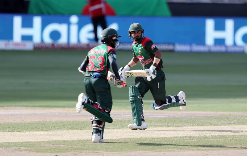 DUBAI , UNITED ARAB EMIRATES, September 28 , 2018 :- Left to Right - Mehidy Hasan and Liton Das of Bangladesh running between the wickets during the final of Unimoni Asia Cup UAE 2018 cricket match between Bangladesh vs India held at Dubai International Cricket Stadium in Dubai. ( Pawan Singh / The National )  For News/Sports/Instagram/Big Picture. Story by Paul