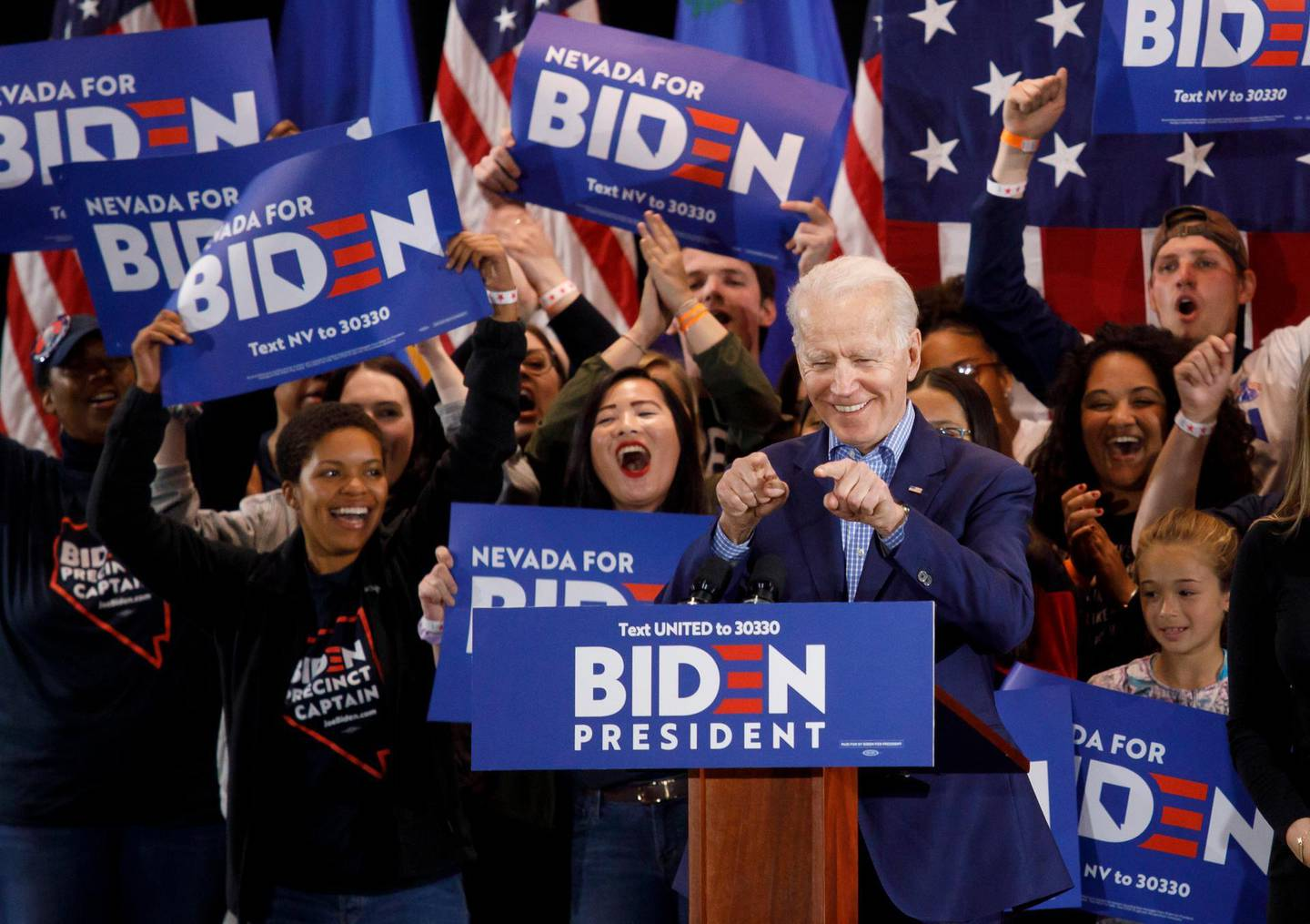 epa08468181 US Democratic presidential candidate, former Vice President Joe Biden (C, front), reacts as he addresses supporters during his Nevada post-caucus rally in Las Vegas, Nevada, USA, 22 February 2020 (reissued 06 June 2020). According to media reports on 06 June 2020, Biden officially secured the Democratic Party presidential nomination after receiving the required number of delegates via state primaries. Biden has campaigned mainly from his home due to the ongoing coronavirus pandemic.  EPA/EUGENE GARCIA