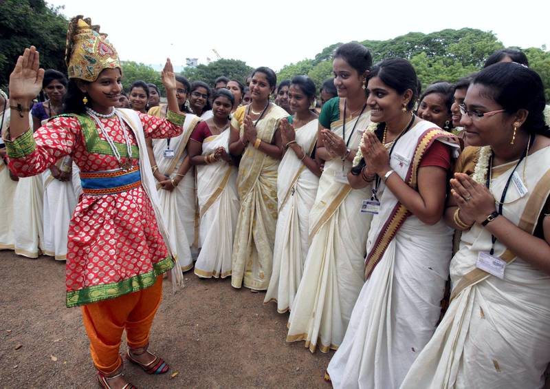 Indian students pose for a photograph as they celebrate the Onam Festival at a college campus in Channai on August 27, 2015. AFP PHOTO / STR (Photo by STRDEL / AFP)