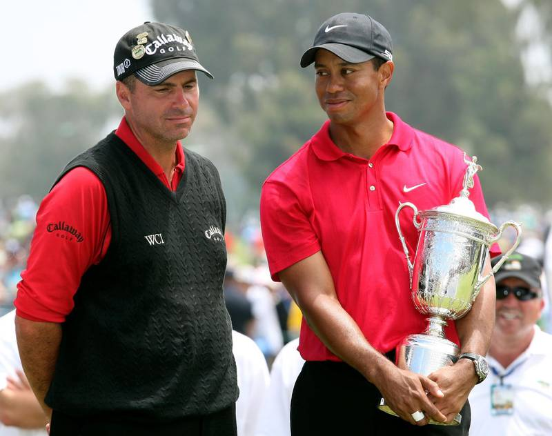 SAN DIEGO - JUNE 16:  Tiger Woods stands with runner-up Rocco Mediate after winning on the first sudden death playoff hole during the playoff round of the 108th U.S. Open at the Torrey Pines Golf Course (South Course) on June 16, 2008 in San Diego, California.  (Photo by Ross Kinnaird/Getty Images)