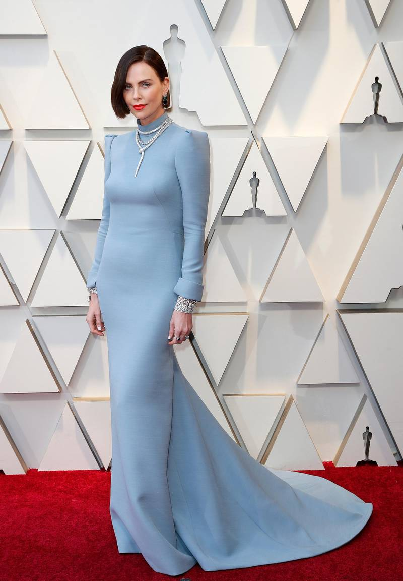 epa07394601 Charlize Theron arrives for the 91st annual Academy Awards ceremony at the Dolby Theatre in Hollywood, California, USA, 24 February 2019. Blue dress by Dior Haute Couture, Serpenti design jewels by Bulgari. The Oscars are presented for outstanding individual or collective efforts in 24 categories in filmmaking.  EPA-EFE/ETIENNE LAURENT