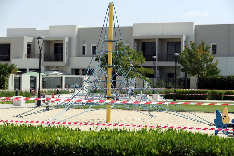 Dubai, United Arab Emirates - Reporter: N/A: A park is closed off with red and white tape. Tuesday, March 17th, 2020. Town Square, Dubai. Chris Whiteoak / The National