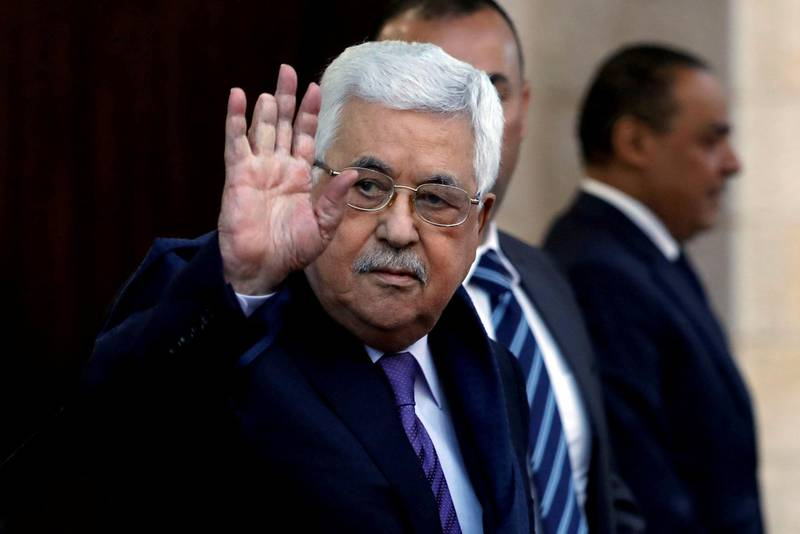 FILE PHOTO - Palestinian President Mahmoud Abbas waves in Ramallah, in the occupied West Bank May 1, 2018. REUTERS/Mohamad Torokman/File Photo