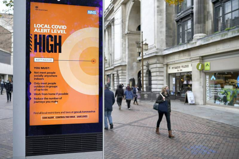 NOTTINGHAM, ENGLAND - OCTOBER 28: People walk through Nottingham City centre ahead of Tier Three restrictions on October 28, 2020 in Nottingham, England.  The city of Nottingham is set to join other parts of England in the Tier 3 'Very High' coronavirus (Covid-19) pandemic restrictions on Friday. (Photo by Christopher Furlong/Getty Images)