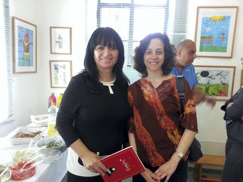 Melissa, right, with Persepolis Haifa School library.