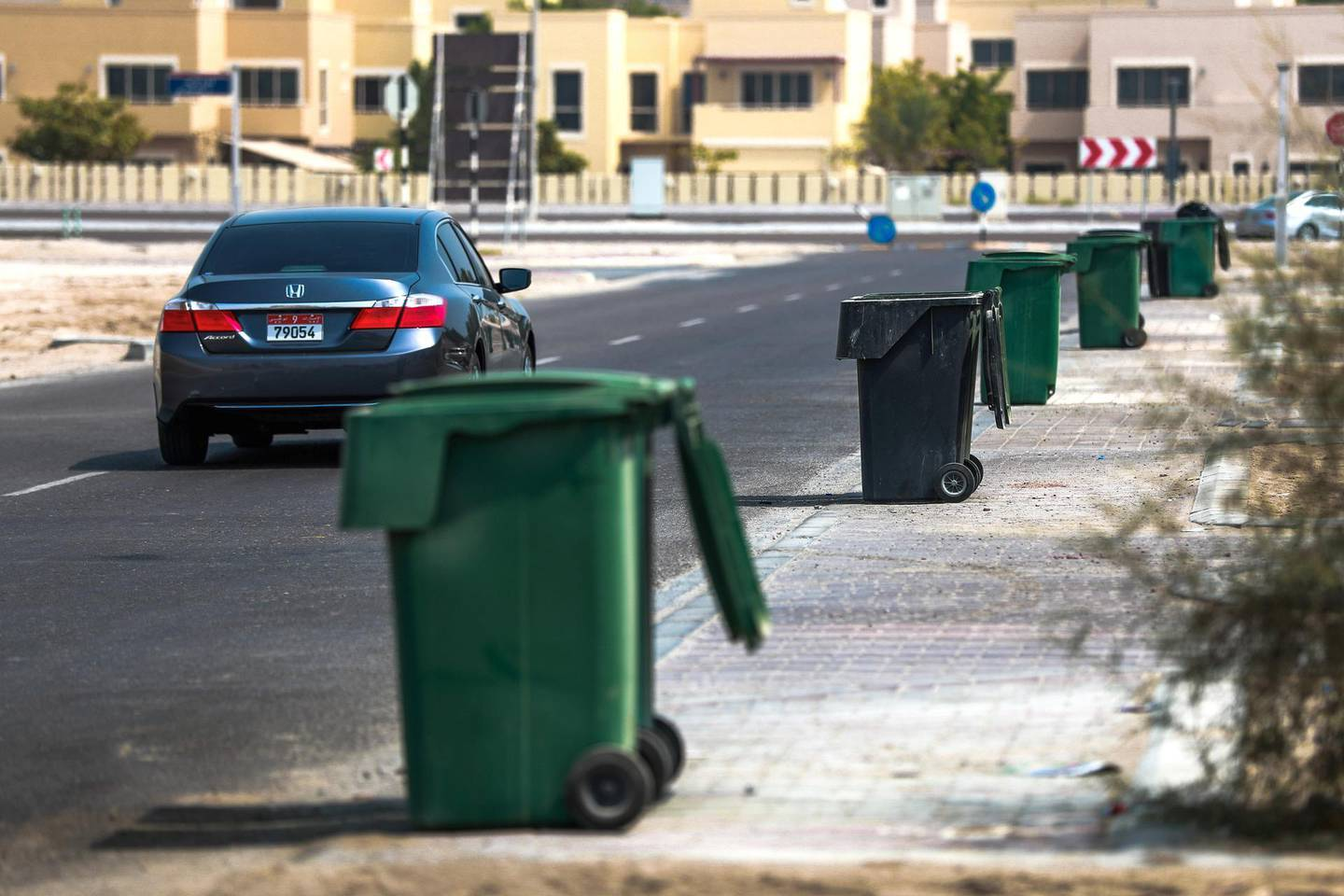 Abu Dhabi, U.A.E., July 22, 2018.  standalone--  Garbage bins waiting for the waste mangement truck on a Sunday morning at Khalifa City.Victor Besa / The NationalSection:  NAReporter: