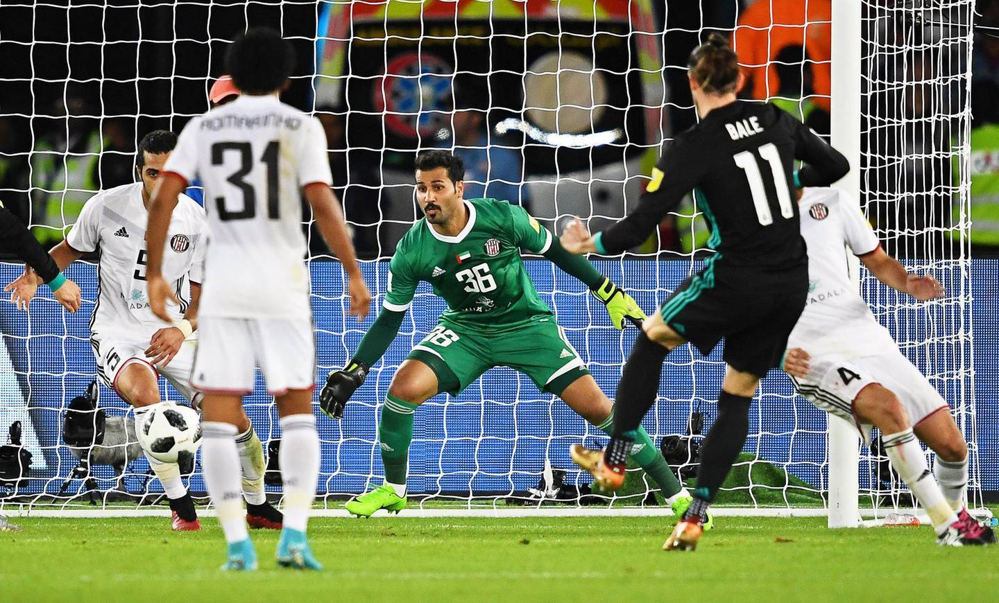 epa06387773 Gareth Bale (2-R) of Real Madrid scores the winning goal during the FIFA Club World Cup semi final soccer match between Al Jazira Club and Real Madrid in Abu Dhabi, United Arab Emirates, 13 December 2017. Real Madrid won 2-1.  EPA/MARTIN DOKOUPIL