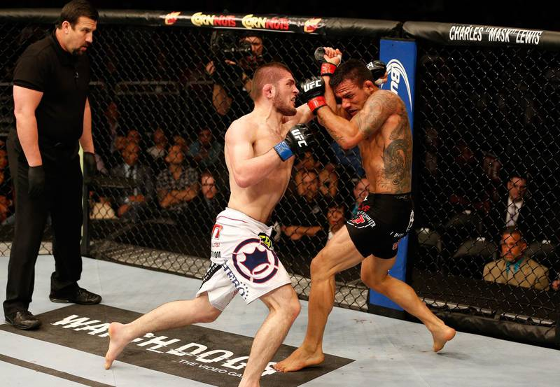 ORLANDO, FL - APRIL 19:  (L-R) Khabib Nurmagomedov punches Rafael dos Anjos in their lightweight bout during the FOX UFC Saturday event at the Amway Center on April 19, 2014 in Orlando, Florida. (Photo by Josh Hedges/Zuffa LLC/Zuffa LLC via Getty Images)