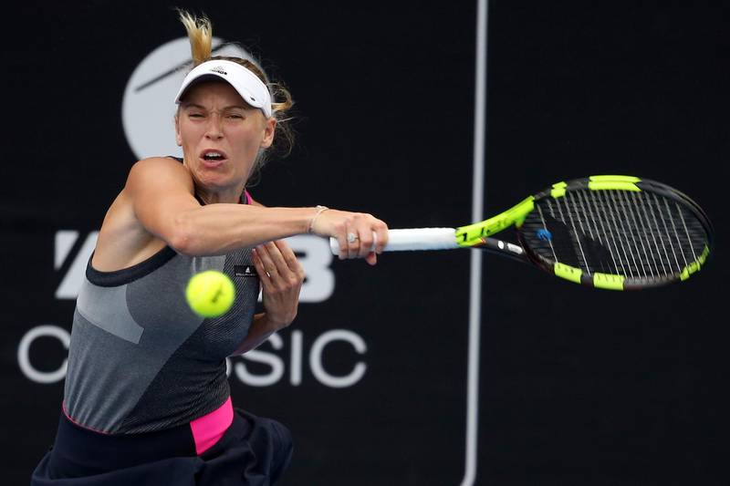 Caroline Wozniacki of Denmark hits a return against Sachia Vickery of the US during their women's singles semi-final match at the WTA Auckland Classic tennis tournament in Auckland on January 6, 2018. / AFP PHOTO / MICHAEL BRADLEY