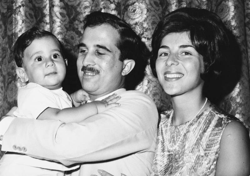 Princess Firyal of Jordan with Prince Muhammad bin Talal holding their son Prince Talal bin Muhammad on his first birthday, 26th July 1966. (Photo by Hulton Archive/Getty Images)