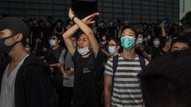 Hong Kong delays extradition bill debate after tens of thousands protest