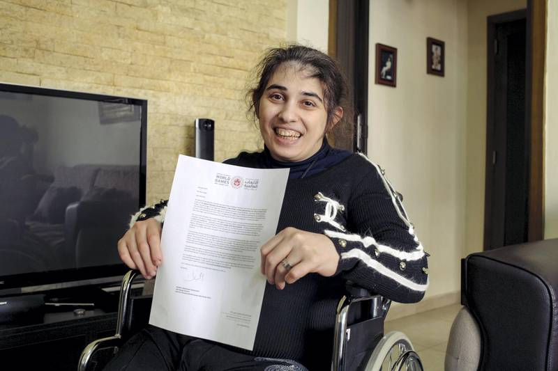 Rita holds her invitation to the Special Olympics held in Abu Dhabi