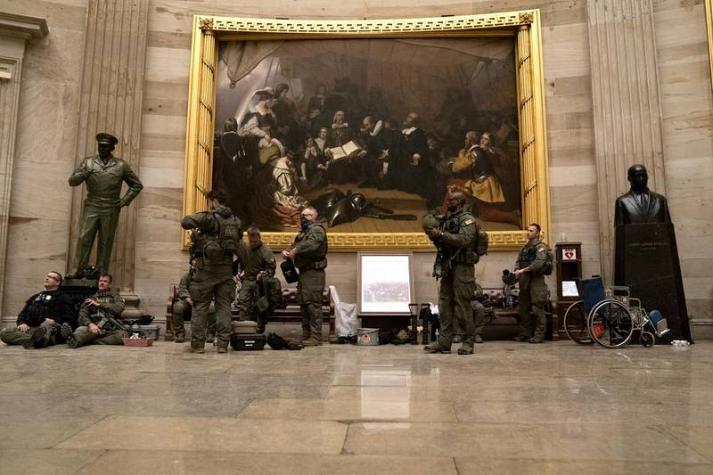 Police in riot gear sit in the rotunda of the U.S. Capitol in Washington, D.C., U.S., on Wednesday, Jan. 6, 2021. The House and Senate resumed a politically charged debate over the legitimacy of the presidential election hours after a pro-Trump mob stormed the U.S. Capitol and drove lawmakers from their chambers. Photographer: Stefani Reynolds/Bloomberg