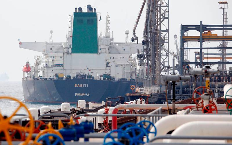 """(FILES) This file photo taken on March 12, 2017  shows an Panamanian tanker docking at the platform of the oil facility in the Khark Island, on the shore of the Gulf. The United States warned June 26, 2018 that countries around the world must stop buying Iranian oil before November 4 or face a renewed round of American economic sanctions. A senior State Department official warned foreign capitals """"we're not granting waivers"""" and described tightening the noose on Tehran as """"one of our top national security priorities.""""  / AFP / ATTA KENARE"""
