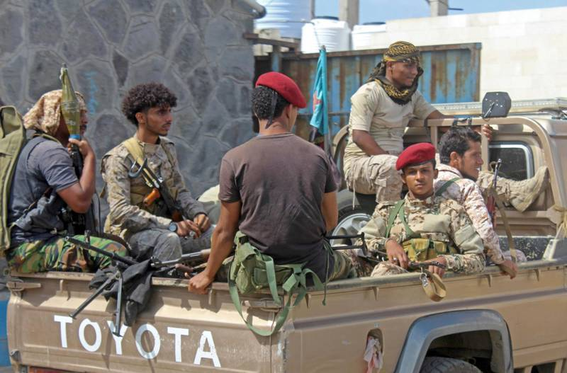Yemeni military security personnel sit in the back of a pick up truck at the airport in the southern city of Aden on January 3, 2021, as activity resumes after explosions rocked the building on December 30, killing or injuring dozens of people. The deadly blasts targeted cabinet members of Yemen's new government, killing at least 26 people, including three members of the International Committee of the Red Cross and a journalist. / AFP / Saleh OBAIDI