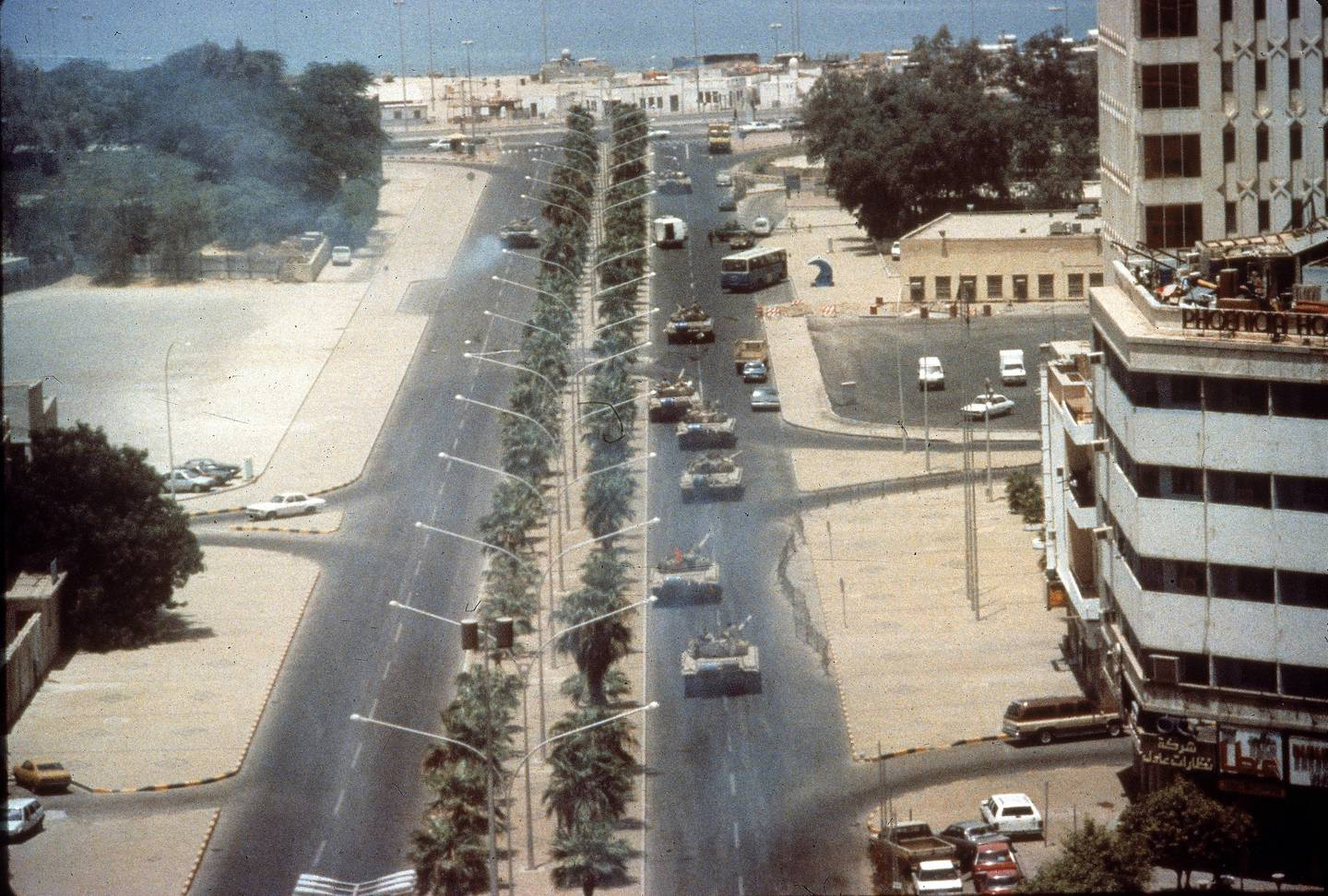 RESIZED Aerial view of Iraqi tanks as they drive along a tree-lined boulevard during that country's invasion of Kuwait City, Kuwait, August 2, 1990. (Photo by The LIFE Images Collection/Getty Images)