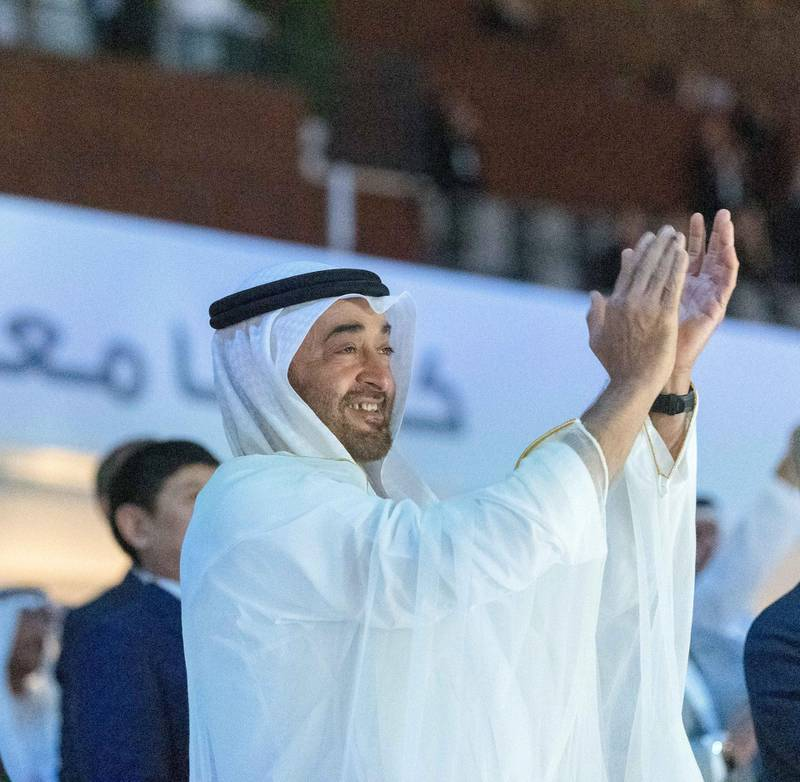ABU DHABI, UNITED ARAB EMIRATES - March 14, 2019: HH Sheikh Mohamed bin Zayed Al Nahyan, Crown Prince of Abu Dhabi and Deputy Supreme Commander of the UAE Armed Forces (C), applauds the UAE team during the opening ceremony of the Special Olympics World Games Abu Dhabi 2019, at Zayed Sports City.  ( Ali Essa ) ---