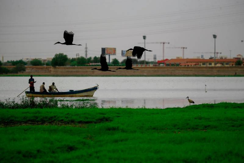 Fishermen sail across the Nile river in the Sudanese capital Khartoum on June 9, 2020.  / AFP / ASHRAF SHAZLY