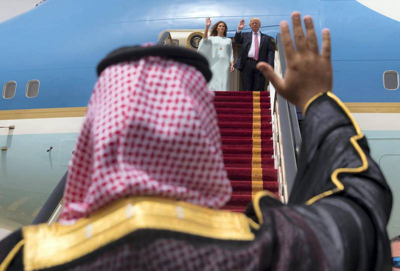"""A handout picture provided by the Saudi Royal Palace on May 22, 2017, shows US President Donald Trump and First Lady Melania Trump waving as they board Air Force One before leaving Riyadh to Israel. (Photo by BANDAR AL-JALOUD / Saudi Royal Palace / AFP) / RESTRICTED TO EDITORIAL USE - MANDATORY CREDIT """"AFP PHOTO / SAUDI ROYAL PALACE / BANDAR AL-JALOUD"""" - NO MARKETING - NO ADVERTISING CAMPAIGNS - DISTRIBUTED AS A SERVICE TO CLIENTS"""
