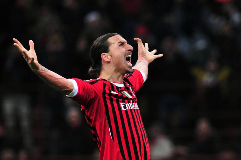 (FILES) In this file photo taken on February 15, 2012 AC Milan's Swedish forward Zlatan Ibrahimovic kicks and score a penalty during the UEFA Champions League round of 16 first leg match AC Milan vs Arsenal at San Siro stadium in Milan. Swedish star Zlatan Ibrahimovic has signed a six-month contract with Serie A side AC Milan with the option of an additional year, the Italian club said in a statement on December 27, 2019. Ibrahimovic played for two seasons between 2010 and 2012 with Milan, helping them to their last Serie A title. The 38-year-old left Los Angeles Galaxy last month following the club's elimination from the Major League Soccer playoffs.  / AFP / Giuseppe CACACE