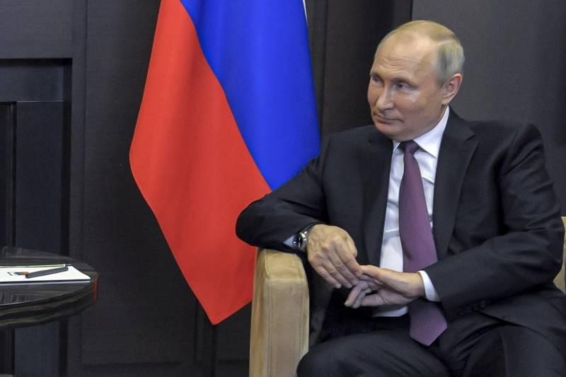 Russian President Vladimir Putin listens to Belarusian President Alexander Lukashenko during their meeting in the Black Sea resort of Sochi, Russia, Friday, May 28, 2021. (Mikhail Klimentyev, Sputnik, Kremlin Pool Photo via AP)