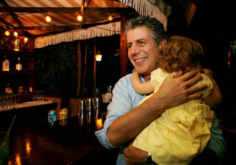 """FILE - In this Nov. 12, 2008 file photo, Chef Anthony Bourdain holds his daughter Ariane in Miami Beach. Court papers show that Bourdain was worth $1.2 million when he died last month. Most of the estate has been left to his daughter, who is now 11-years-old. Bourdain was found dead June 8 in an apparent suicide in his French hotel room while working on his CNN series """"Parts Unknown."""" (AP Photo/Lynne Sladky, File)"""