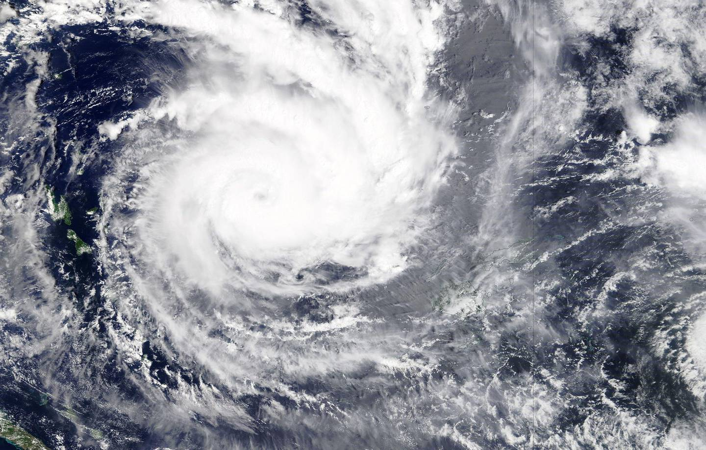 epa08886661 A handout satellite image released by NASA from its Terra satellite shows the Category five Cuclone Yasa north-west of Fiji's Viti Levu island on 15 December 2020 (issued 16 December 2020). Cyclone Yasa is expected to make landfall over Fiji late 17 December or early 18 December 2020.  EPA/NASA / HANDOUT  HANDOUT EDITORIAL USE ONLY/NO SALES