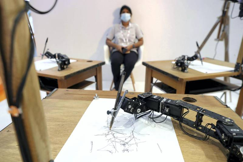 Dubai, United Arab Emirates - December 06, 2020: AI Art technology sketches a person during GITEX 2020 at the World Trade Centre. December 6th, 2020 in Dubai. Chris Whiteoak / The National