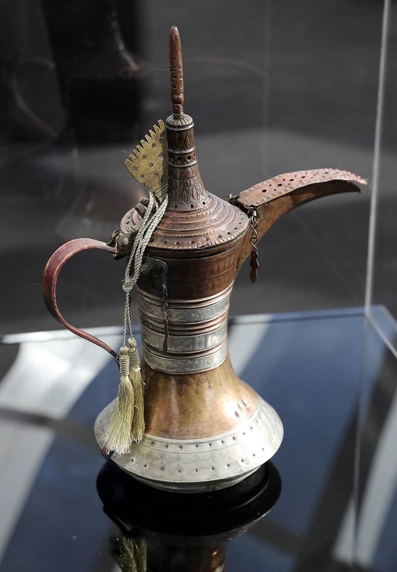 ABU DHABI , UNITED ARAB EMIRATES , JAN 27 – 2018 :- Dallah used in the Emirates of Abu Dhabi in the early 20th century ( Al Hosn ) on display during the Majlis Zayed Exhibition held at the 90th floor of Burj Mohammed bin Rashid in Abu Dhabi. The rare personal belongings used by the late Sheikh Zayed Bin Sultan Al Nahyan on display at the exhibition.  (Pawan Singh / The National) For News.