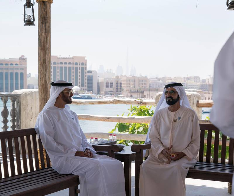 DUBAI, UNITED ARAB EMIRATES - March 20, 2018: HH Sheikh Mohamed bin Zayed Al Nahyan Crown Prince of Abu Dhabi Deputy Supreme Commander of the UAE Armed Forces (L), speaks with HH Sheikh Mohamed bin Rashid Al Maktoum, Vice-President, Prime Minister of the  UAE, Ruler of Dubai and Minister of Defence (R), prior to the signing of a joint venture agreement between Aldar and Emaar, in Shindagha Heritage District.   ( Mohamed Al Hammadi / Crown Prince Court - Abu Dhabi ) ---