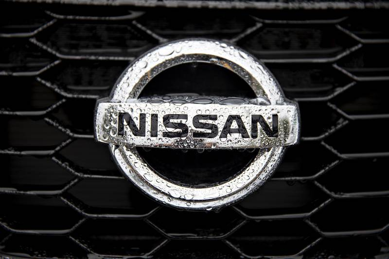 A Nissan Motor Co. badge is seen on the grill of a vehicle at a car dealership in Joliet, Illinois, U.S., on Wednesday, Oct. 2, 2019. Auto salesin the U.S. probably took a big step back in September, setting the stage for hefty incentive spending by carmakers struggling to clear old models from dealers' inventory. Photographer: Daniel Acker/Bloomberg