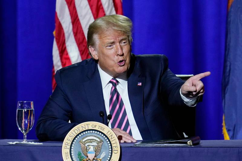 President Donald Trump engages with the crowd as he participates in a Latinos for Trump Coalition roundtable Monday, Sept. 14, 2020, in Phoenix. (AP Photo/Ross D. Franklin)