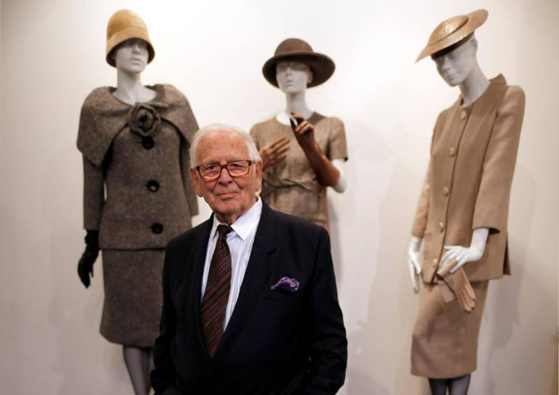 """FILE PHOTO: French fashion designer Pierre Cardin poses in front of his 1954-1956-1957 fashion creations in his museum called """"Past-Present-Future"""" in Paris November 12, 2014. REUTERS/Charles Platiau/File Photo"""