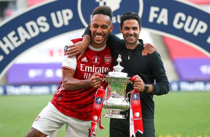 epa08579588 Arsenal's head coach Mikel Arteta (R) and his player Pierre-Emerick Aubameyang (L) celebrate with the trophy after the English FA Cup final between Arsenal London and Chelsea FC at Wembley stadium in London, Britain, 01 August 2020.  EPA/Cath Ivill/NMC/Pool EDITORIAL USE ONLY. No use with unauthorized audio, video, data, fixture lists, club/league logos or 'live' services. Online in-match use limited to 120 images, no video emulation. No use in betting, games or single club/league/player publications.