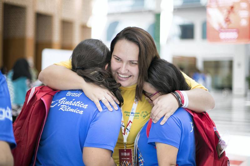 ABU DHABI, UNITED ARAB EMIRATES - March 20 2019.  Brazil's bocce athlete Sarah Berto embraces her teammates  at the Special Olympics World Games in ADNEC.    (Photo by Reem Mohammed/The National)  Reporter:  Section:  NA