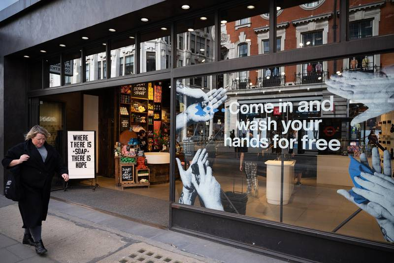 LONDON, ENGLAND - MARCH 17: A woman walks past a cosmetic store that is offering a free hand-washing facility on March 17, 2020 in London, England. Boris Johnson held the first of his public daily briefing on the Coronavirus outbreak yesterday and told the public to avoid theatres, going to the pub and work from home where possible. The number of people infected with COVID-19 in the UK reached 1500 today with 36 deaths. (Photo by Leon Neal/Getty Images)