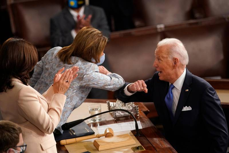 President Joe Biden elbow bumps House Speaker Nancy Pelosi of Calif., after speaking to a joint session of Congress Wednesday, April 28, 2021, in the House Chamber at the U.S. Capitol in Washington, as Vice President Kamala Harris watches. (AP Photo/Andrew Harnik, Pool)